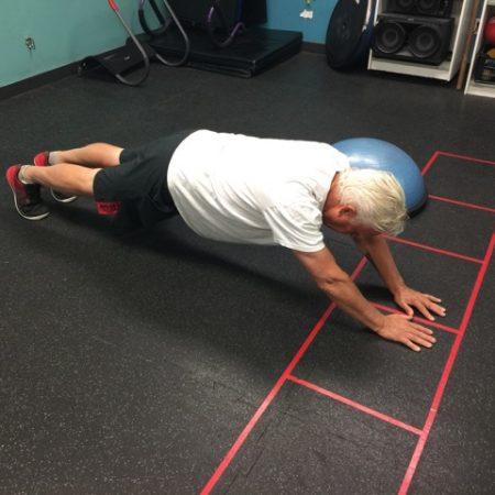 A person does a plank in a gym in OK Falls, in the South Okanagan.